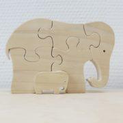 Puzzelolifant met jong naast elkaar